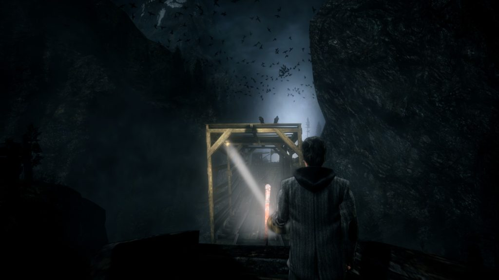 Alan Wake: riding a mining car in darkness across a bridge surrounded by birds