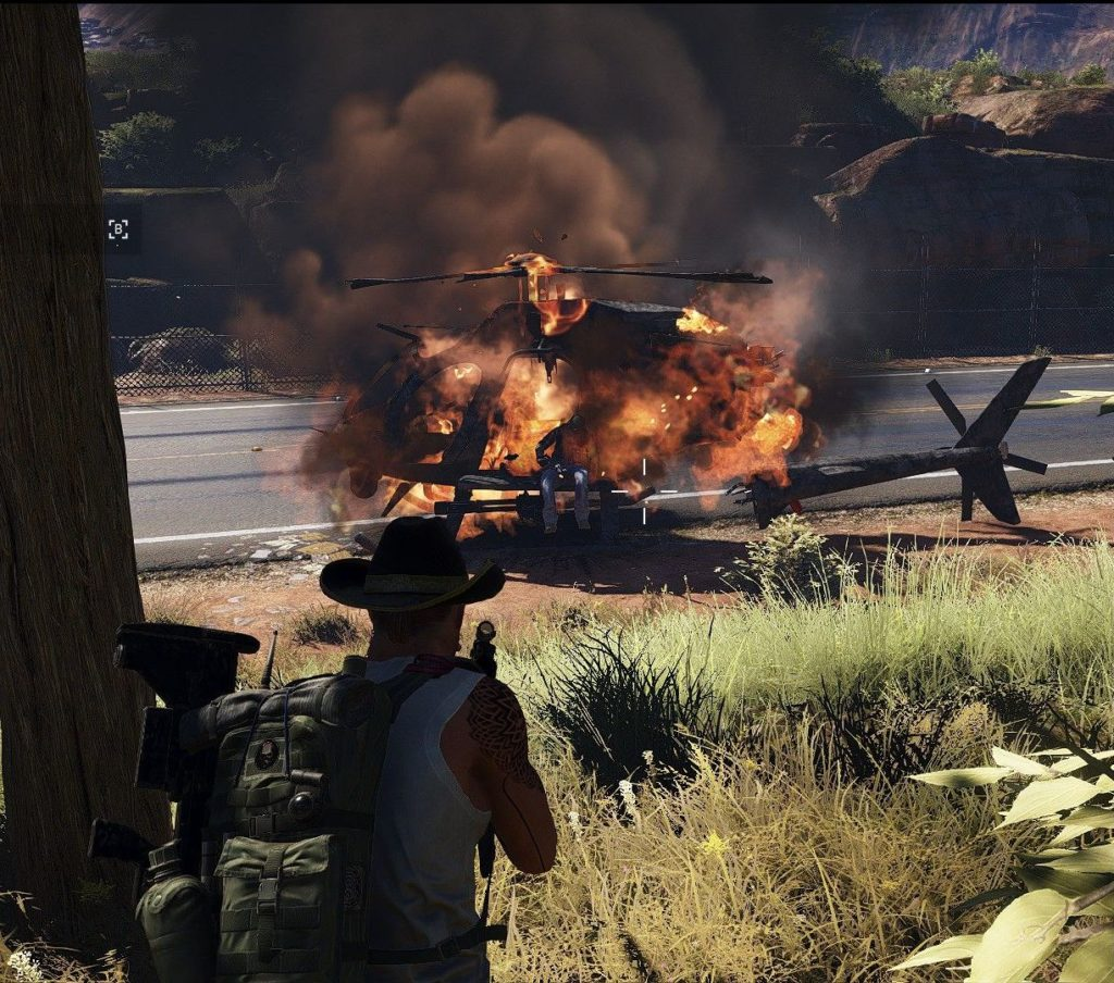Ghost Recon Wildlands: a man sitting in a burning helicopter